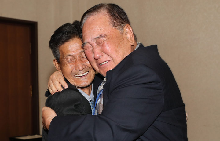 South Korean Ham Sung-chan, 93 hugs his North Korean brother Ham Dong Chan, 79 during a separated family reunion meeting at the Mount Kumgang resort on the North's southeastern coast