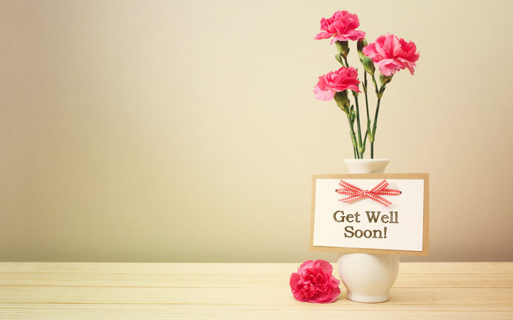 43085943 - get well soon message with pink carnations in a white vase