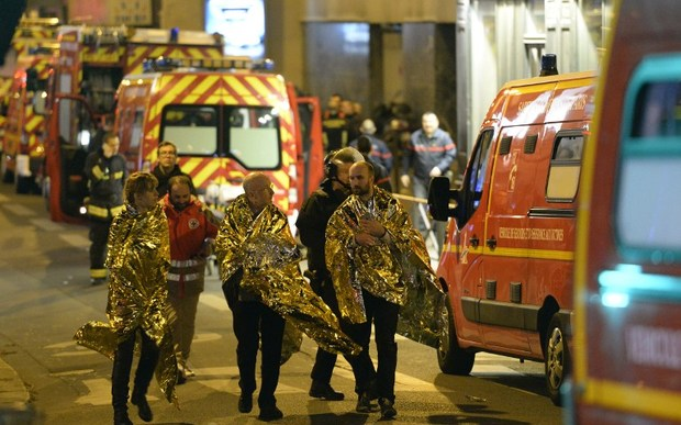 People are being evacuated on rue Oberkampf near the Bataclan concert hall in central Paris