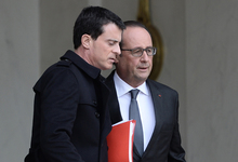 Prime Minister Manuel Valls (left) and President Francois Hollande leave a security meeting on Saturday.