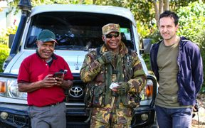 Johnny Blades with PNG earthquake response official, Matthew Waram and PNG Defence Force soldier Kavin Haihe