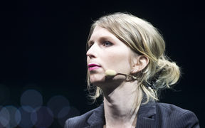 Former US soldier Chelsea Manning speaks during the C2 conference in Montreal, Quebec, on May 24, 2018. / AFP PHOTO / Lars Hagberg