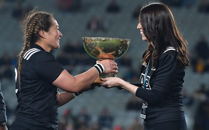 New Zealand's captain Fiao'o Faamausili is presented the Laurie O'Reilly Cup by Prime Minister of New Zealand Jacinda Ardern during the Black Ferns vs Australia Women's rugby match at Eden Park.