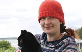 Cat-lover Nico Jarvis, of Omaui, holding her neighbour's 8-year-old cat, Nhabuz Fishaw.