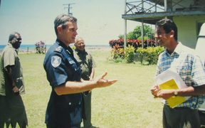 Andrew Hughes (left) in his role as Fiji Police Commissioner visits Cawaci where he meets Mr. Darren Koch (right) a fellow Australian who taught in Cawaci.