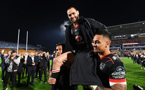 Simon Mannering is carried from the field by team mates David Fusitu'a and Ken Maumalo after playing his 300th match.