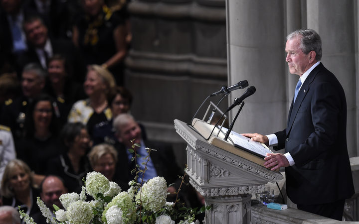 Former US President George W. Bush speaks during a memorial service for US Senator John McCain at the Washington National Cathedral in Washington, DC.
