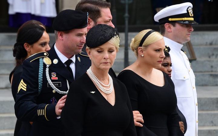 (L-R) James McCain, Cindy McCain, Meghan McCain, Bridget McCain, John Sydney McCain watch as a Military Honor Guard carries the casket of US Senator John McCain at the end of his memorial service for  at the Washington National Cathedral in Washington, DC.