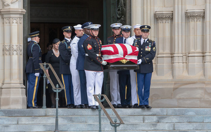 Megan McCain looks on as a Military Honor Guard carrying the casket of late Senator John McCain, Republican of Arizona, exits the National Cathedral after a funeral service at the National Cathedral in Washington, DC.
