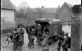 Wounded New Zealand soldiers are placed in a motorised ambulance in France.