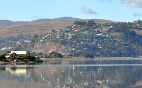 A panorama of Christchurch estuary in the foreground with the hill suburb of Redcliffs in the background.