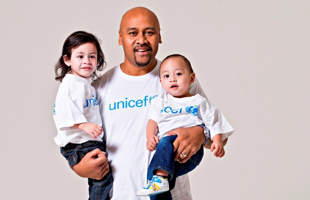 Jonah Lomu - pictured with his sons Brayley and Dhyreille - supported several charities, including UNICEF.
