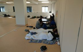 Some New Zealanders in Yongah Hill Detention Centre mess hall where they have been kept since riots.
