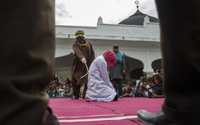 File photo of a woman in Indonesia who was previously caned in public.