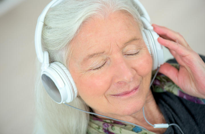elderly woman with headphones