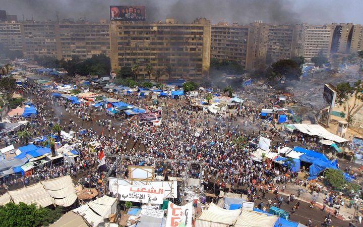 Egyptian security forces intervene civilians at Rabaa al-Adawiya Square where anti-coup demonstrators' held sit-in protests