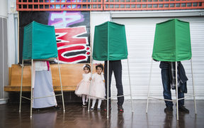 People vote in the Swedish general elections at a polling station in the suburb of Rinkeby, north of Stockholm.