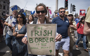 A protester holds a signs expressing her concerns regarding the Irish border at the people's vote march in London, United Kingdom where thousands rallied to protest against Brexit on June 23 and ask for a referendum on the final Brexit deal.