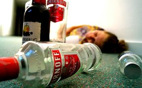 woman passed out with alcohol bottles