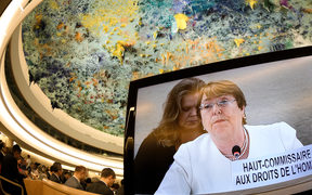 New High Commissioner for Human Rights Michelle Bachelet is seen on a TV screen delivering her speech during the opening day of the 39th UN Council of Human Rights in Geneva on September 10, 2018.