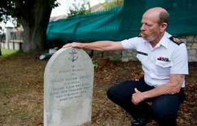 Warrant Officer Ken Bancroft, who is leading the vigil team of Royal New Zealand Navy sailors, at the headstone of Engine Room Artificer Apprentice Philip Short.
