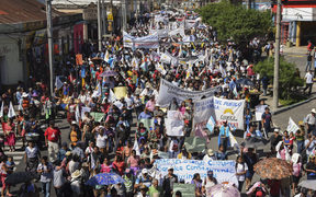 Members of the Peasant Development Committee march to demand the resignation of Guatemalan President Jimmy Morales and the renewal of the mandate of an anti-corruption mission of the UN, in Guatemala City on September 12, 2018.