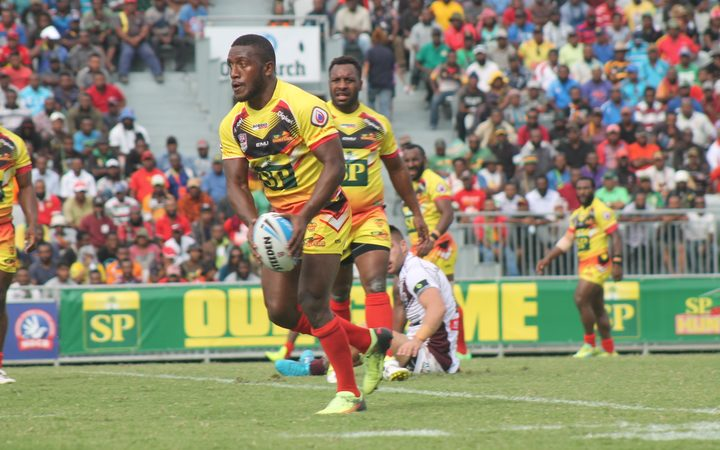 PNG Hunters halfback Watson Boas shapes to kick.