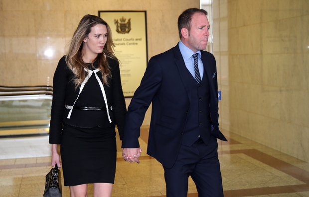 Ex-Megaupload executive Finn Batato and his wife Anastasia leave court for lunch