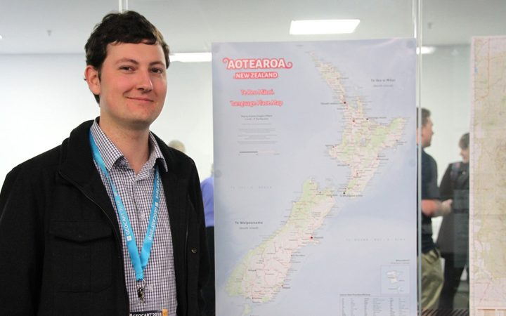 Andrew Douglas Clifford with his wall poster te reo map.