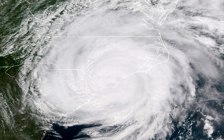 Satellite image taken on 14 September, 2018, shows Hurricane Florence hitting the US east coast.
