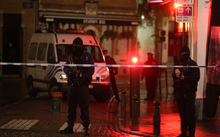 Belgian police officers secure an area in Brussels on Sunday,