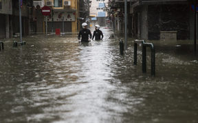 Rescue workers make their way through floodwaters during a rescue operation during Super Typhoon Mangkhut in Macau.