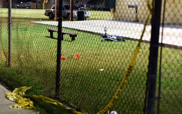 Evidence markers sit on the ground after a shooting at Bunny Friend Park in New Orleans, Louisiana, on 22 November 2015.