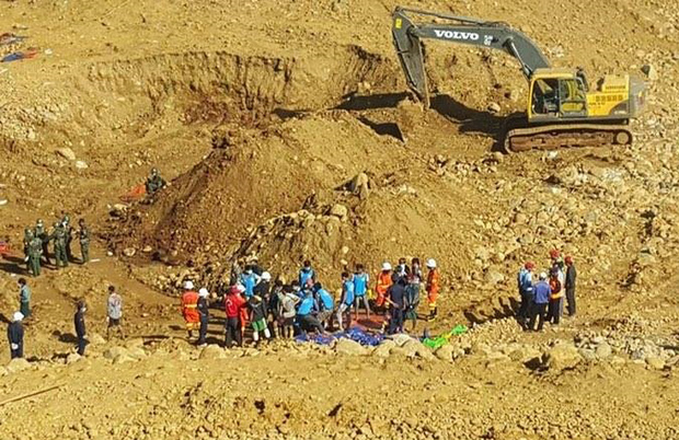 Soldiers and rescue workers search for the bodies of miners killed in a landslide in a jade mining area in Hpakhant, in nothern Myanmar.