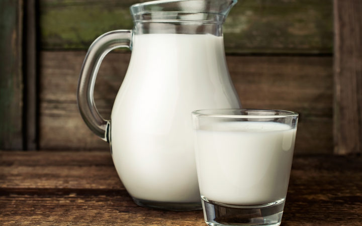 Milk in glass jug.