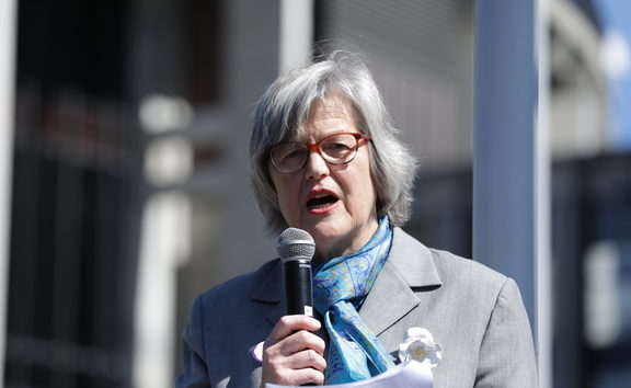 Eugenie Sage speaking on the steps of Parliament