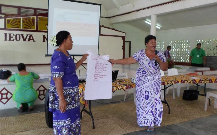 Women present their findings during public consultations.