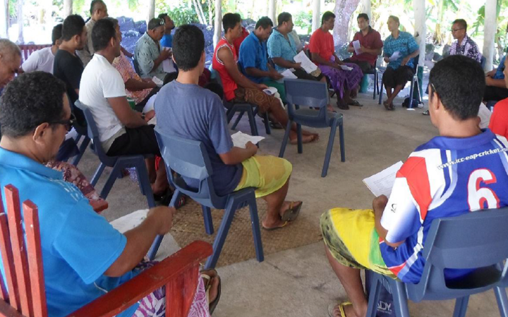 A group of men in Samoa participate in the inquiry.