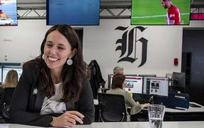 PM Jacinda Ardern propping a special suffrage edition of the New Zealand Herald with editor Miriyana Alexander.
