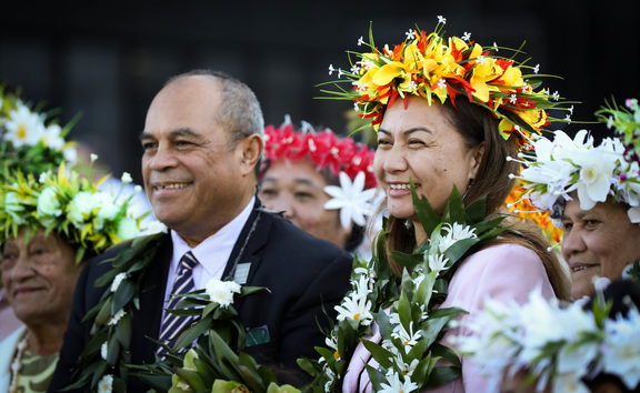 Minister for Pacific Peoples Aupoito William Sio (left) and Green Party co-leader Marama Davidson (right) with members of the Cook Island Community at Parliament to commemorate the 25th anniversary of women's right to vote in New Zealand.