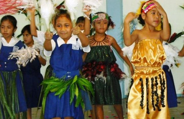 Students at a mission school in Samoa dancing