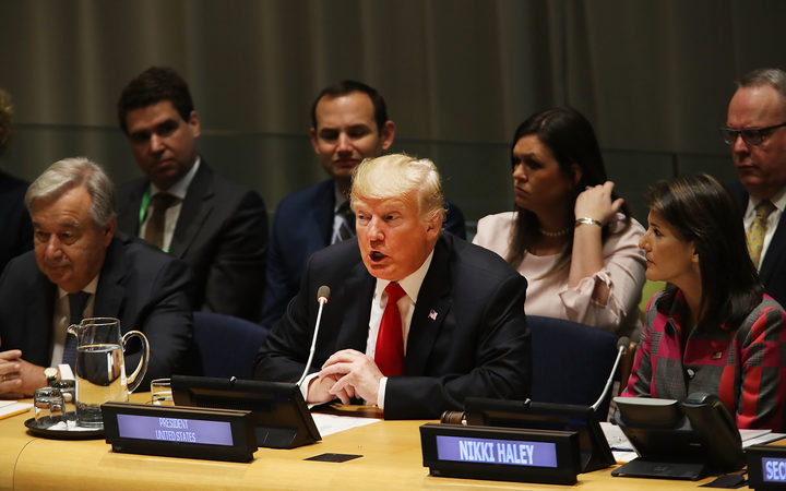 US President Donald Trump attends a meeting on the global drug problem at the United Nations (UN) with UN Ambassador Nikki Haley.