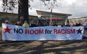 Protesters outside the Gisborne District Council want to make sure the conversation doesn't die down.