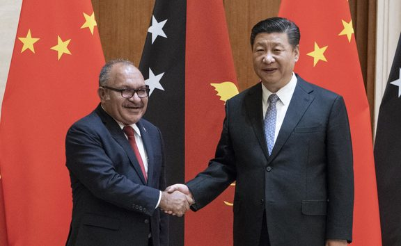 Papua New Guinea's Prime Minister Peter O'Neill (L) shakes hands with China's President Xi Jinping in June.