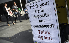 A placard outside the Australian royal commission set up in February to investigate claims of misconduct in the banking sector.
