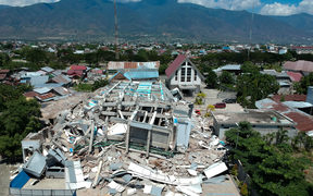 This aerial picture shows the remains of a ten-storey hotel in Palu in Indonesia's Central Sulawesi.