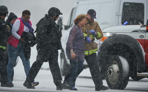 Hostages are escorted to safety during an active shooter situation outside a Planned Parenthood facility