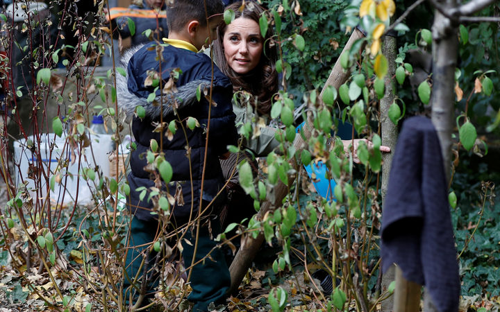 "The duchess helped children search for spiders and other ""mini beasts""."