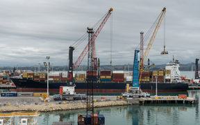 Container ship in commercial port of Napier, New Zealand.