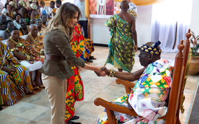 US First Lady Melania Trump shakes hands with Osabarimba Kwesi Atta II, the chieftan of the regional Fante tribe (R), at the Emintsimadze palace in Cape Coast, Ghana.